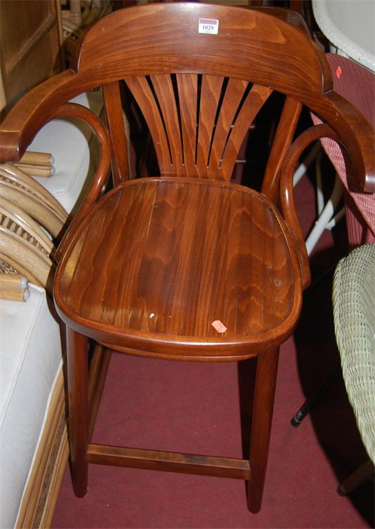 A pair of modern stained beech panelled seat breakfast bar stools