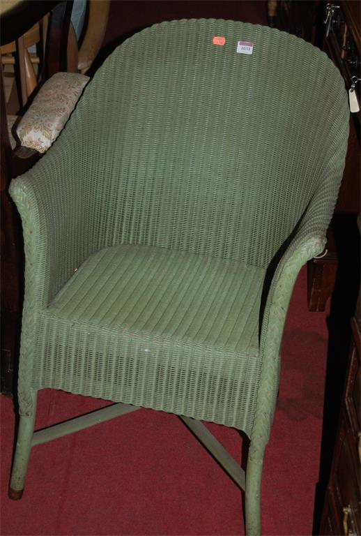 A Lloyd Loom green painted wicker conservatory chair