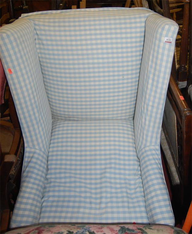 A late 19th century mahogany framed and chequer upholstered armchair