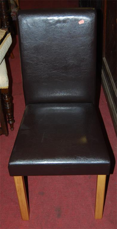 A set of four contemporary dark brown leather upholstered dining chairs