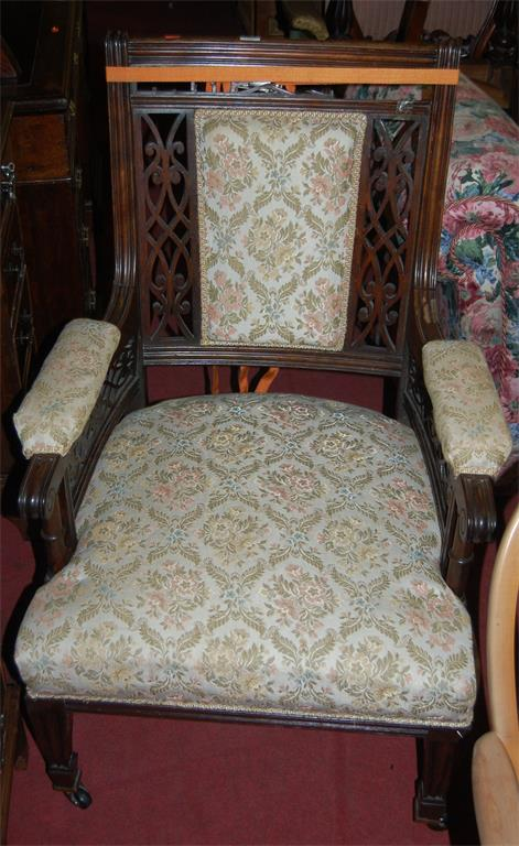 A late Victorian rosewood and floral upholstered three piece parlour suite comprising