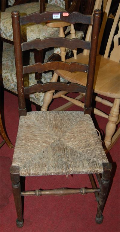 A harlequin set of four Lancashire rush seat dining chairs, together with a ladderback elbow chair (5)