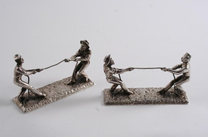 A PAIR OF VICTORIAN PLATED NOVELTY KNIFE RESTS