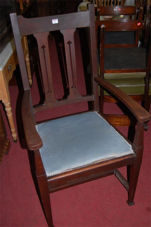 A set of eight Art Nouveau influenced walnut pierced slatback dining chairs