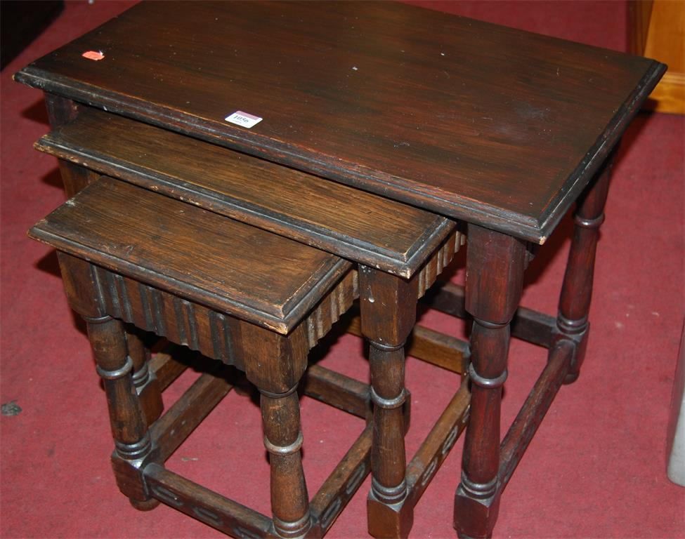 A moulded oak nest of three occasional tables
