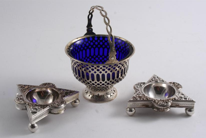 with engraved & bead borders, crested, by Robert Hennell, London 1781 and a pair of pierced shaped oval salts with engraved bord