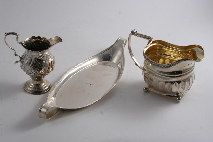 A GEORGE III BOAT-SHAPED SNUFFER'S TRAY