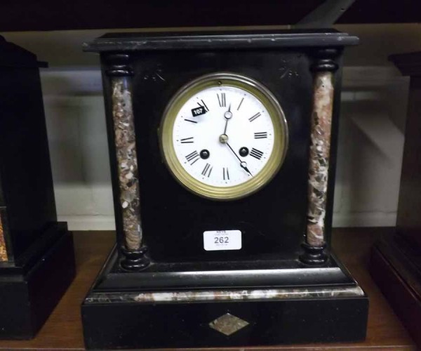 French black slate and marble mantel clock of architectural form, the case with two side pllars, white enamel face with roman nu