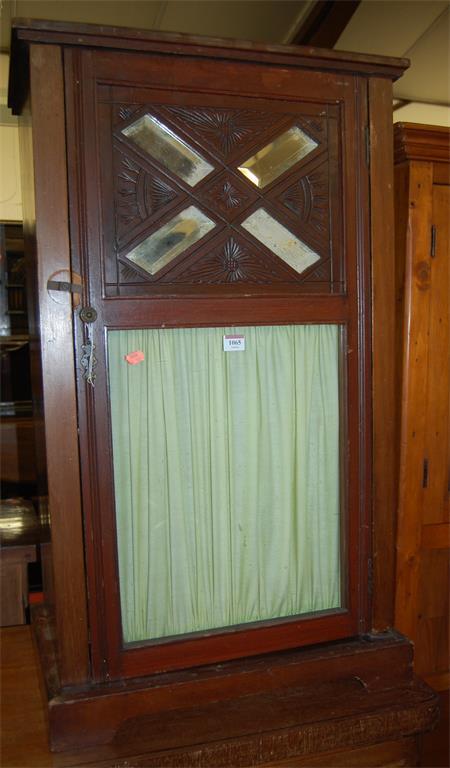 An Edwardian walnut single door glazed music cabinet
