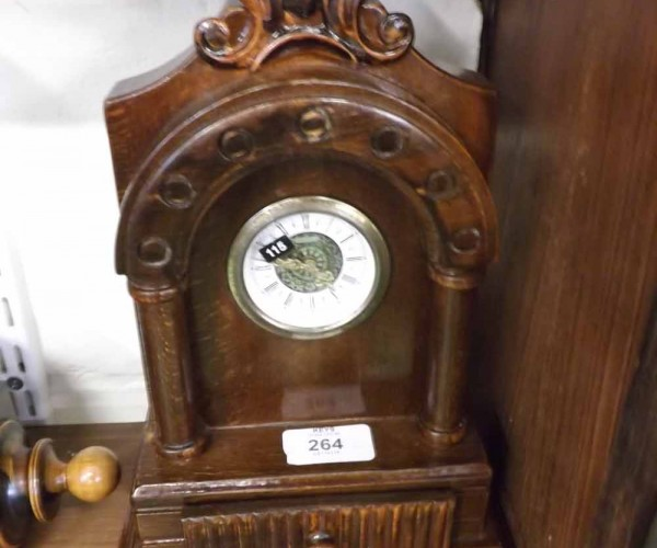 """20th century mantel clock, the stained wooden architectural case with small drawer to base, 10 ½"""" high in total"""