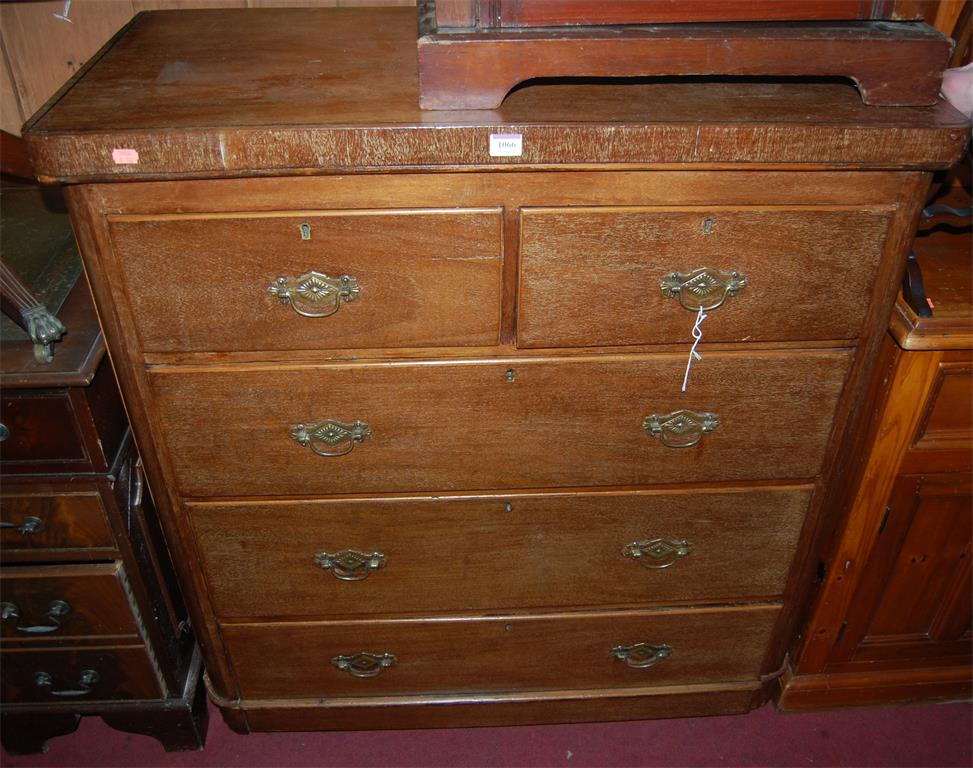 A Victorian mahogany round cornered corner chest of two short over three long drawers