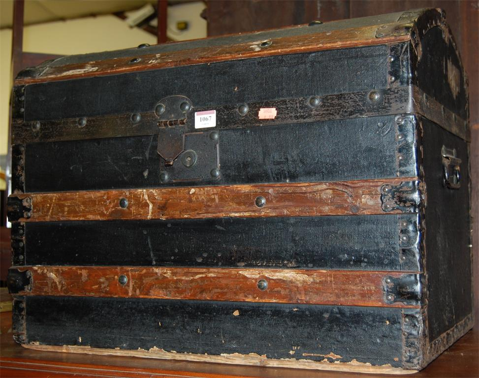 A rexine clad wooden and metal bound hinge-top chest