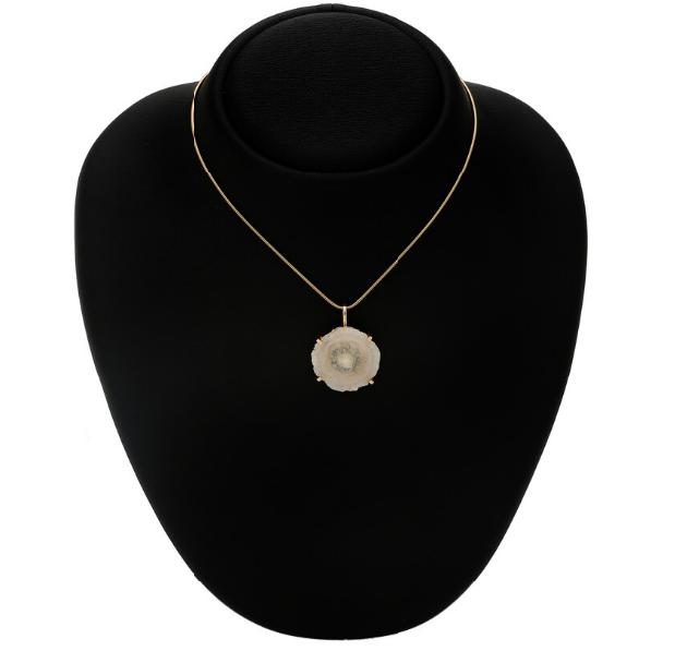 A rock crystal pendant set with a dial of rock crystal, mounted in 14k gold