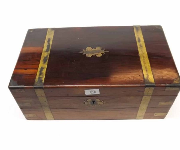 19th century rosewood and brass bound writing box of typical rectangular form, fitted and leather lined interior
