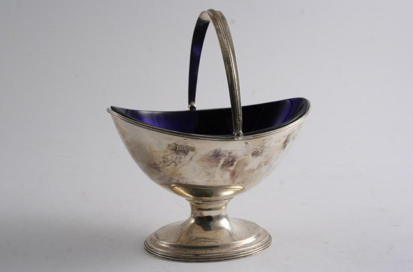 A MODERN SWING HANDLED SUGAR BOWL