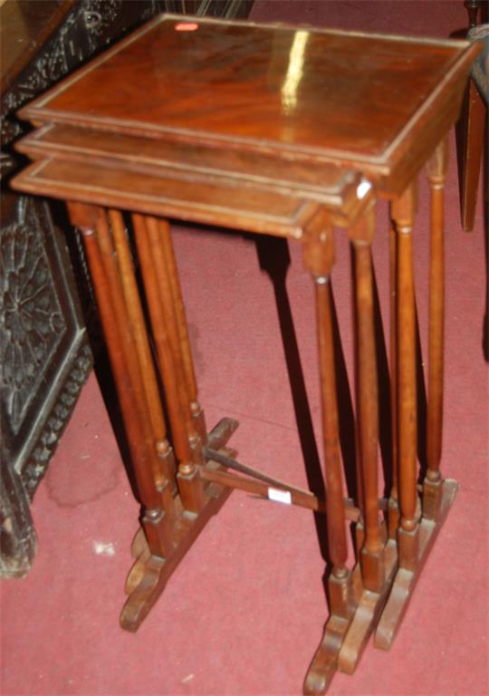 A mahogany nest of three occasional tables