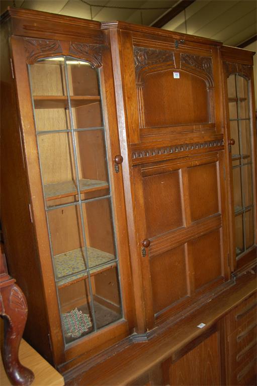 A moulded oak combination bureau bookcase