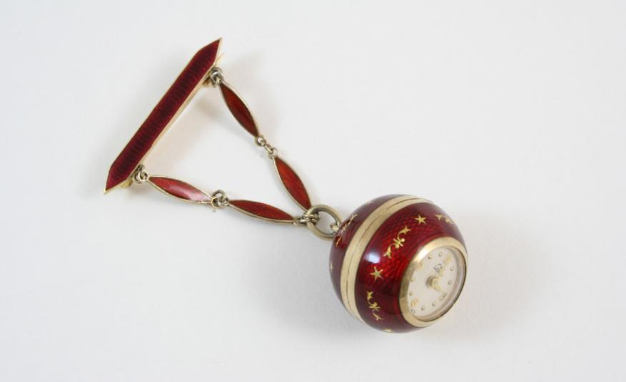 A SWISS RED GUILLOCHE ENAMEL FOB WATCH