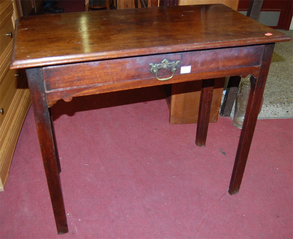 A George III mahogany single drawer side table, raised on chamfered square supports