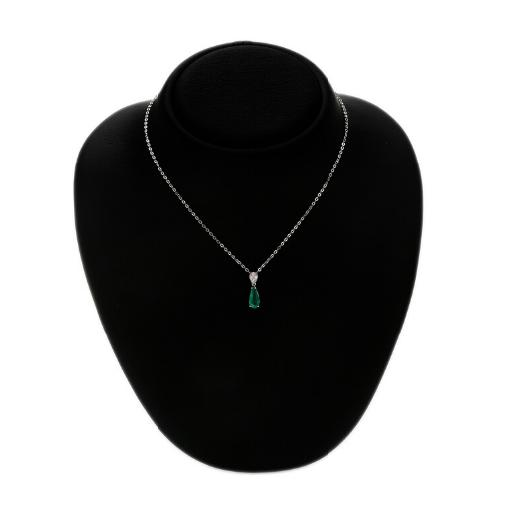 An emerald and diamond pendant set with a pear-shaped emerald