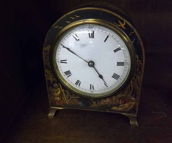 Small early 20th century bedside or mantel clock fitted with French brass movement in a japanned case