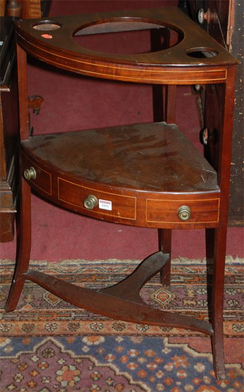 An early 19th century mahogany and satinwood strung bowfront three tier washstand