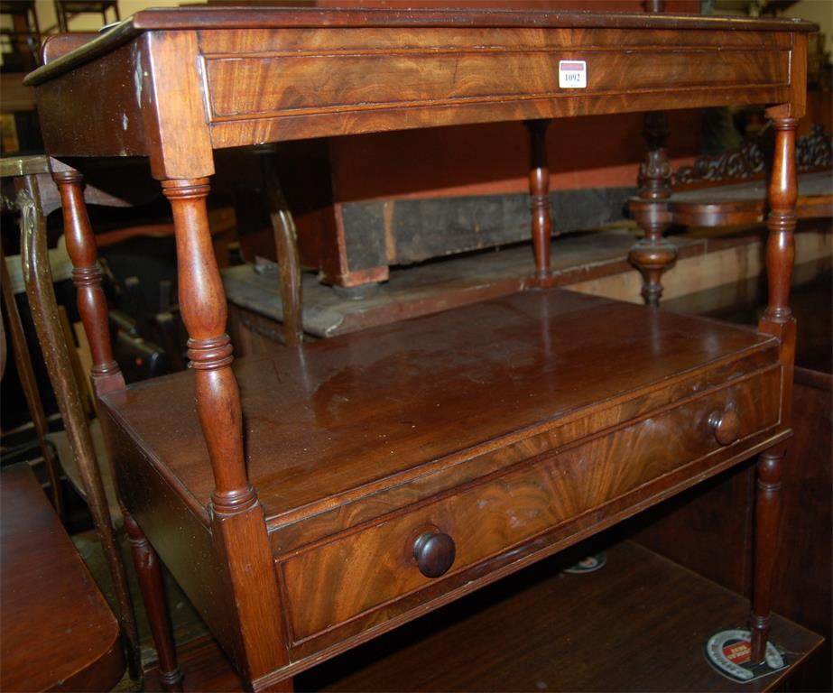A Victorian mahogany ledgeback two tier side table, having single long central drawer