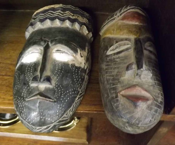 """Pair of 20th century African hardwood tribal masks, approx 12"""" long"""