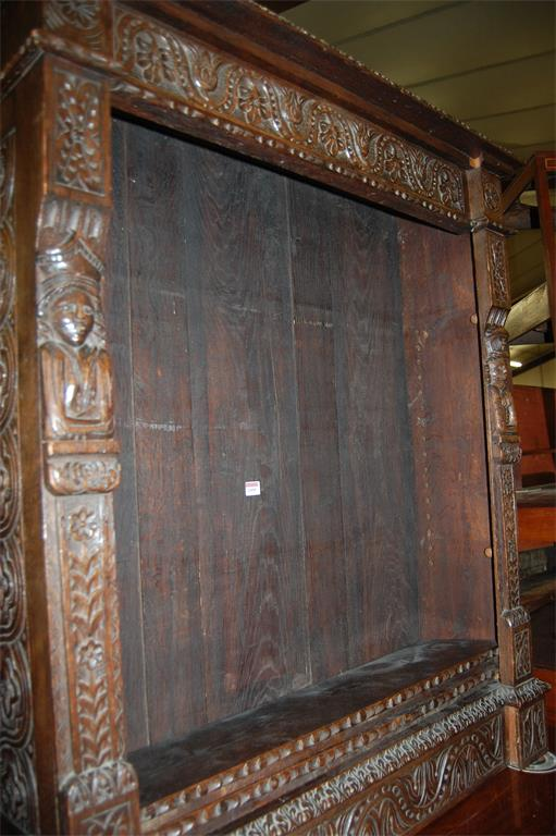A 19th century Continental heavily carved oak freestanding open bookshelf