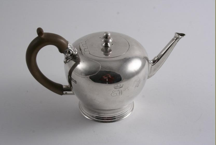 A SMALL BULLET TEA POT