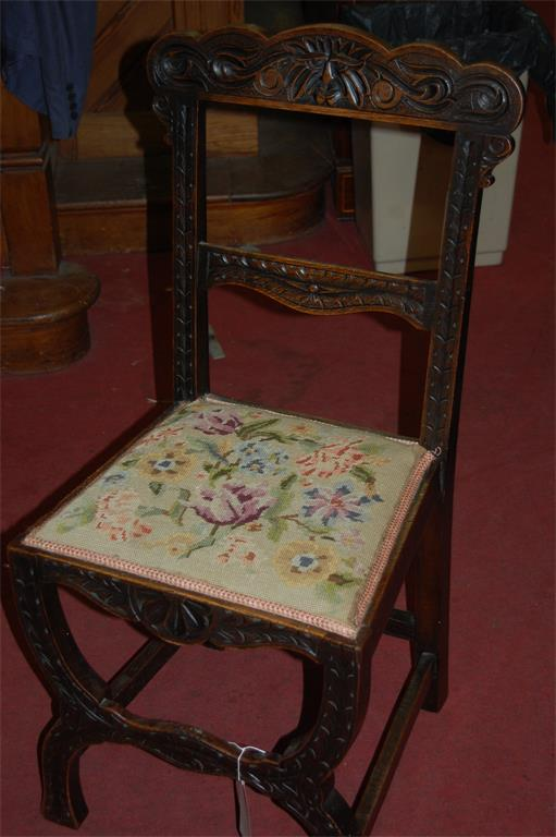 A circa 1900 Continental low relief carved oak single dining chair