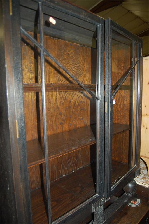 A 1930s oak double door glazed bookcase