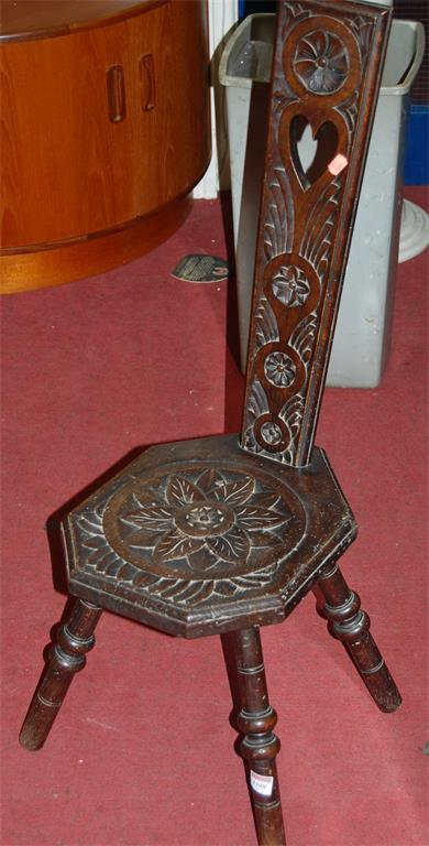 A circa 1900 low relief carved oak Welsh spinning seat