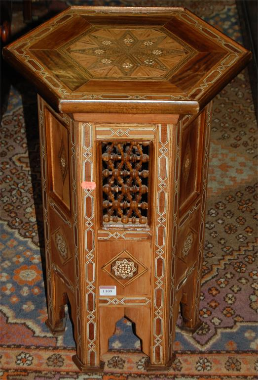 A Moroccan heavily inlaid hexagonal occasional table