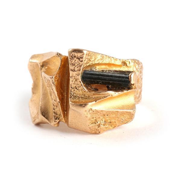 Tourmaline ring set with an unpolished tourmaline crystal