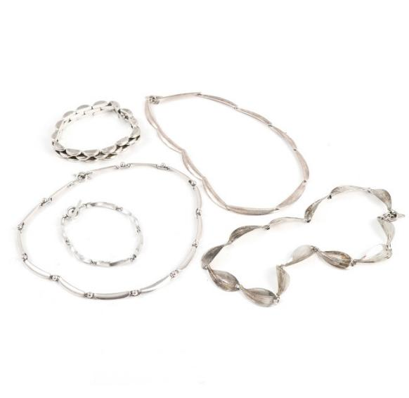 Three silver and sterling silver necklaces and bracelets
