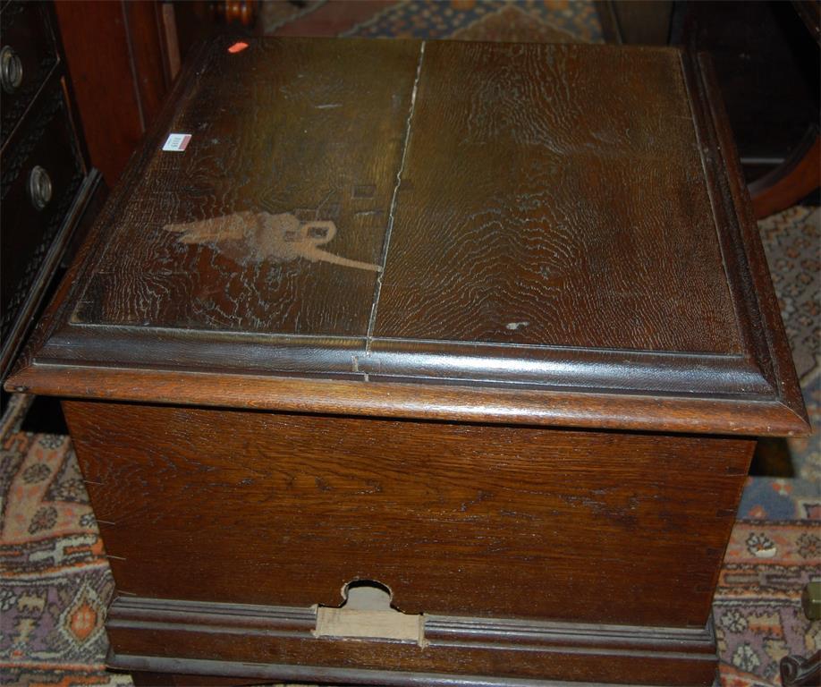 An oak hinge-top chest