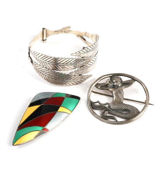 Sterling silver and enamel brooch and bangle and silver brooch. Brooch L. 7.1 cm. (3)