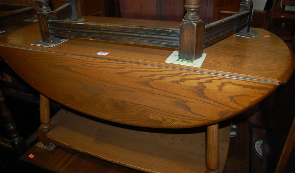 An Ercol mid-elm dropflap two tier coffee table