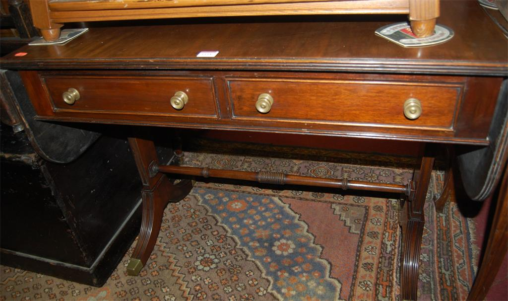 A 19th century mahogany round cornered dropflap sofa table
