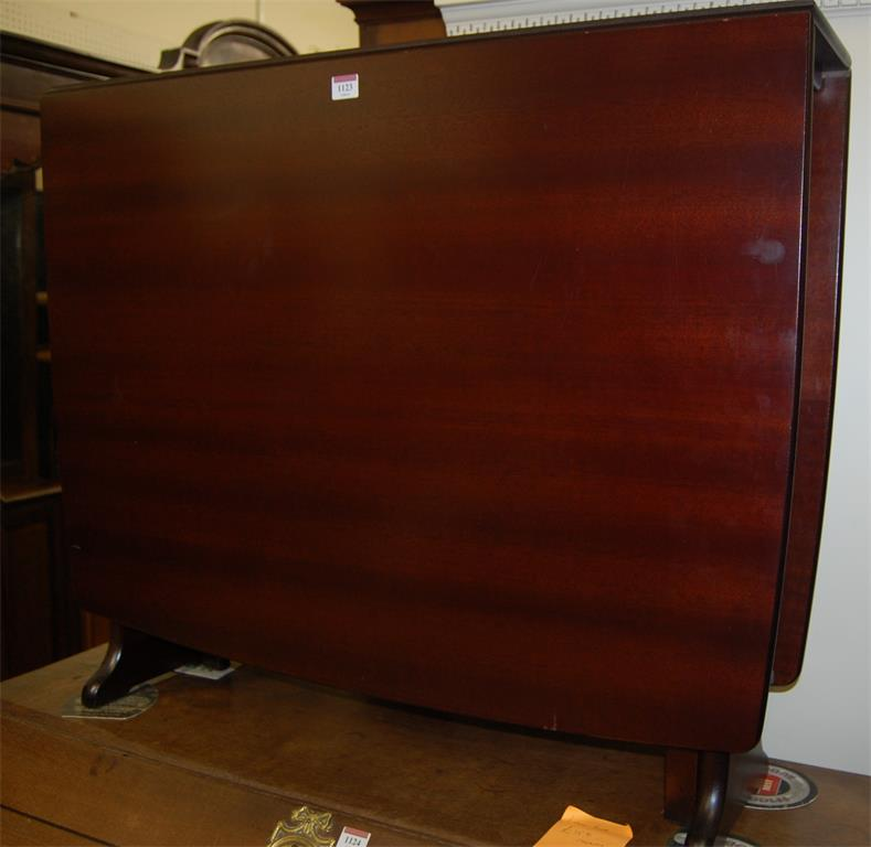 A reproduction mahogany dropleaf kitchen table