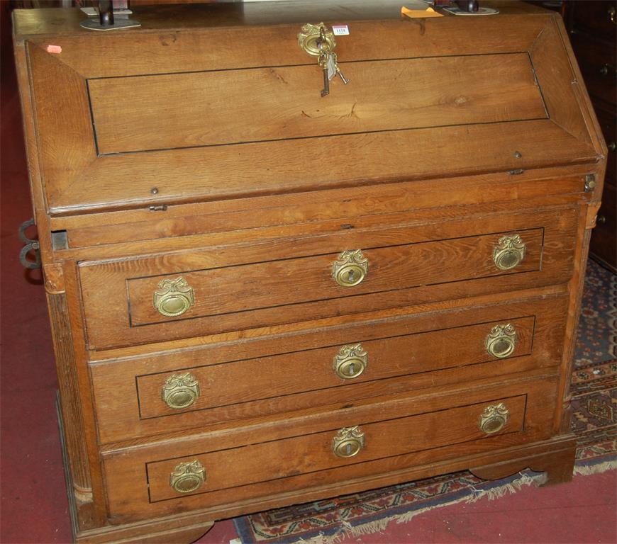 An 18th century provincial French oak slopefront three drawer writing bureau