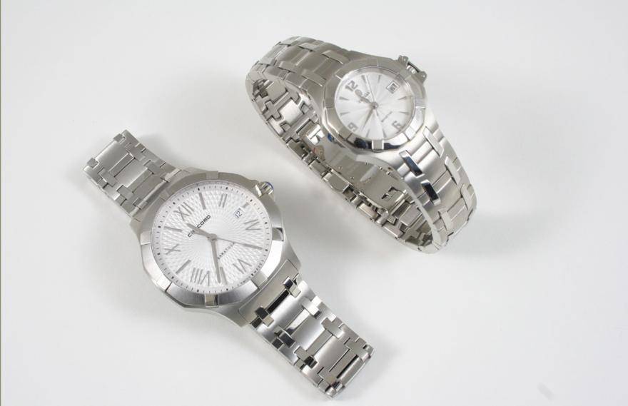 A CASED SET OF STAINLESS STEEL WRISTWATCHES