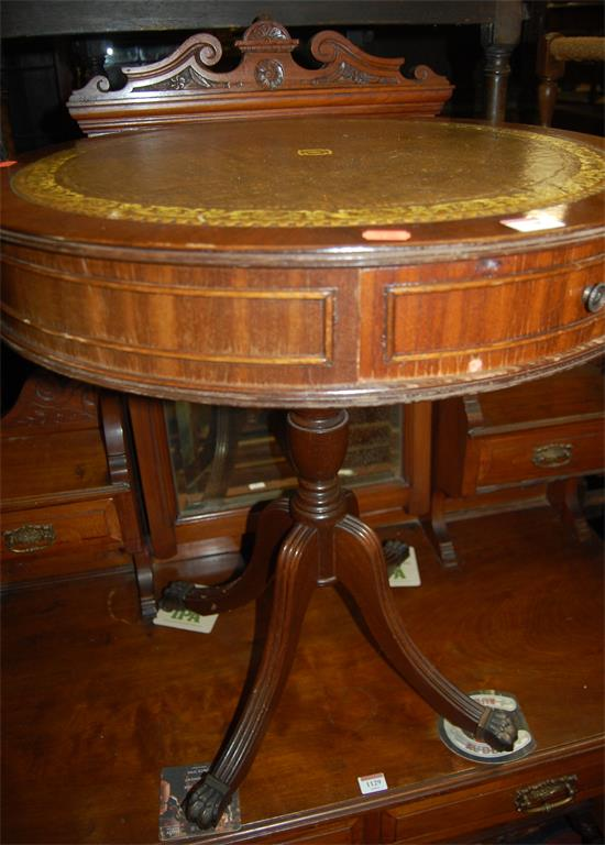 A reproduction mahogany and green leather gilt tooled inset circular pedestal drum table