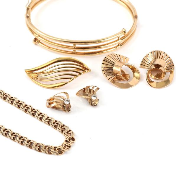 A pair of 18k gold ear clips, 14k gold bangle and bracelel, 8k gold brooch and ear clips