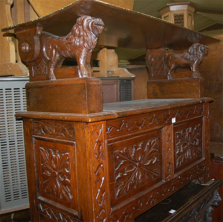 A circa 1900 line carved oak fold-over monks bench, having typical hinged boxseat base
