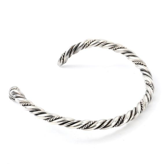 A heavy sterling silver bangle. Weight app. 224 gr