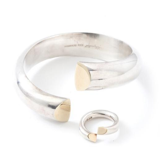 A sterling silver bangle and ring with goldplated end pieces