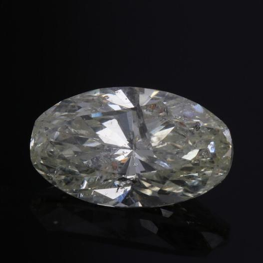 An unmounted oval brilliant-cut diamond weighing app. 3.19 ct. Colour light yellow. Clarity P2