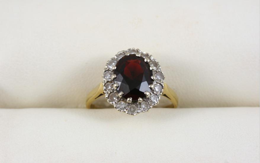 A GARNET AND DIAMOND CLUSTER RING